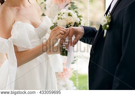 Traditional Wedding Ceremony Of The Bride And Groom. A Beautiful Bride In A Wedding Dress And With A