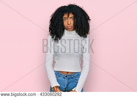 Young african american girl wearing casual clothes depressed and worry for distress, crying angry and afraid. sad expression.