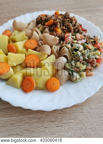 Whole Grain Pasta With Potatoes, Carrots And A Vegetable Salad