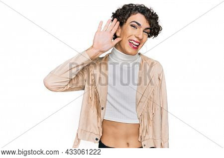Handsome man wearing make up and woman clothes waiving saying hello happy and smiling, friendly welcome gesture