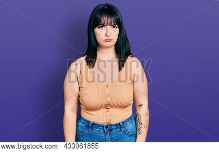 Young hispanic plus size woman wearing casual clothes skeptic and nervous, frowning upset because of problem. negative person.