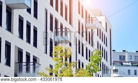 Ecological Housing Architecture. A Modern Residential Building In The Vicinity Of Trees. Ecology And