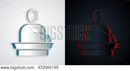 Paper Cut Gives Lecture Icon Isolated On Grey And Black Background. Stand Near Podium. Speak Into Mi