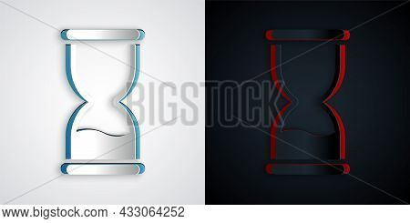 Paper Cut Old Hourglass With Flowing Sand Icon Isolated On Grey And Black Background. Sand Clock Sig