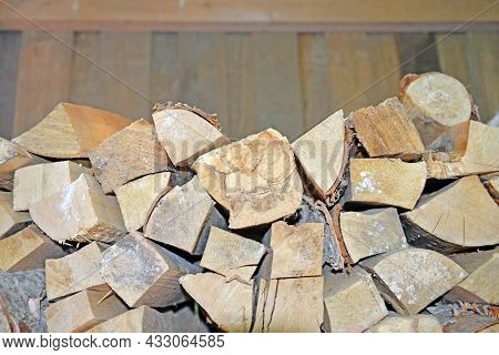 Upper Part Of Woodpile In Woodshed Close-up. Due To Dampness And Inadequate Storage, Some Of Logs Ha