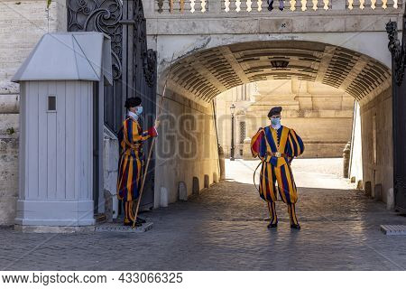 Rome, Italy - August 2, 2021: Soldiers Of The Pontifical Swiss Guard Standing Next To Saint Peter's
