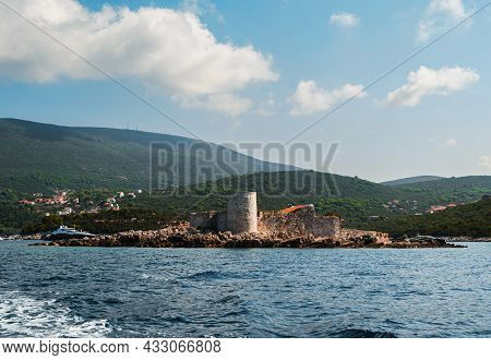 An Island With The Former Austrian Fortress Arza. Mamula Island. In The Background There Is A Mounta
