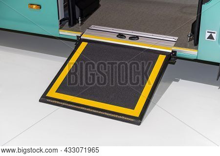 Retractable Bus Ramp For Wheelchair And Baby Stroller Entry. Transport Accessibility For People With