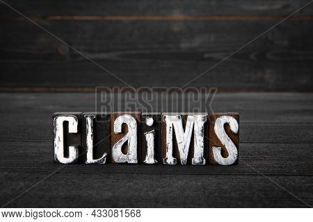 Claims. Laws, Regulations And Policies Concept. White Wooden Letters On A Dark Wooden Background