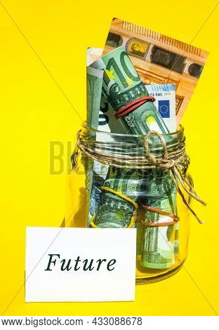 Glass Jars Filled With Euro Bills, Savings Inside Glass Jar, Money Isolated On Yellow Background. Pa