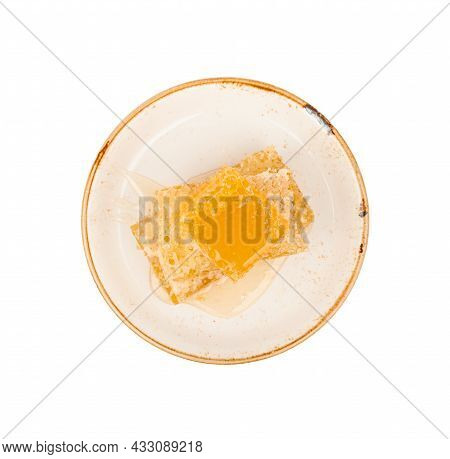 Close Up Stack Of Several Fresh Cut Golden Comb Honey Slices On Plate Isolated On White Background,