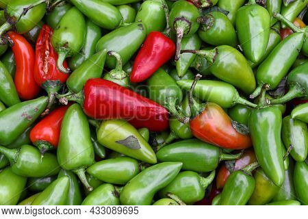 Close Up Heap Of Many Fresh Green And Red Hot Jalapeno Chili Peppers On Retail Display At Farmers Ma