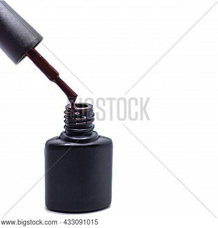 Black Bottle Of Gel Nail Polish With Brush Isolated On White Background, Image For Advertising Nail