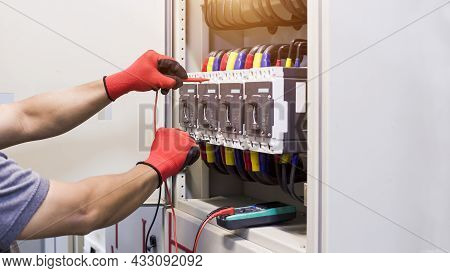 Electrical Engineer Tests The Operation Of The Electric Control Cabinet On A Regular Basis For Maint