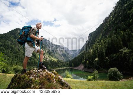 Happy Hiker Winning Reaching Life Goal, Success, Freedom And Happiness, Achievement In Mountains.