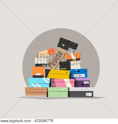 Various Shoe Boxes Lying In A Pile