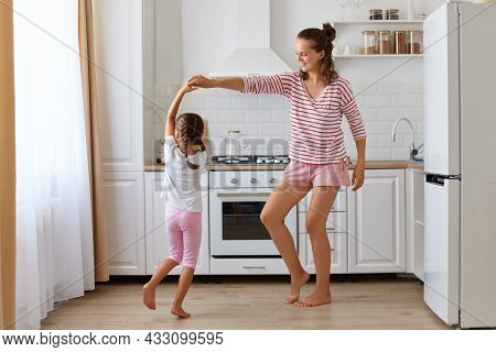 Dark Haired Little Girl Dancing With Mother, Daughter Feeling Amazing Dancing With Her Loving Mother