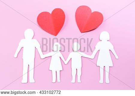Paper Family Cut Out On Bright Pink Background With Paper Heart. Family Home, Foster Care, Family Me