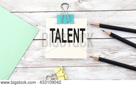 Stickers With Pencils And Notebook With Text Talent On The Wooden Background