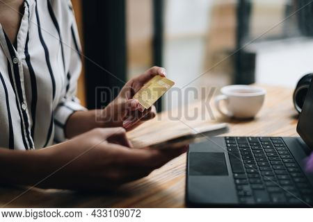 Woman Enjoy With Online Shopping Application On Mobile Phone And Typing Credit Card For Fill Number