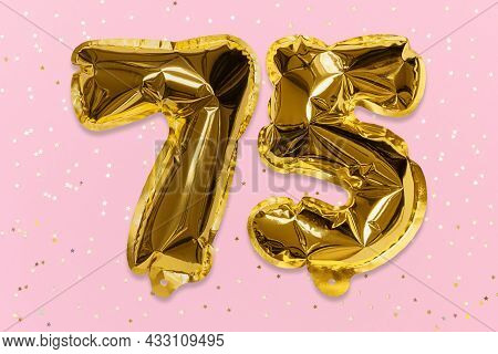 The Number Of The Balloon Made Of Golden Foil, The Number Seventy-five On A Pink Background With Seq