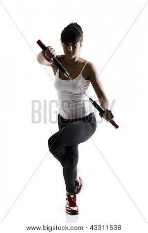 sport karate girl doing exercise with nunchaku, fitness silhouette studio shot over white background