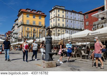 Porto, Portugal - September 11, 2021: Tourists In Protective Masks Walk Along The Promenade In The H