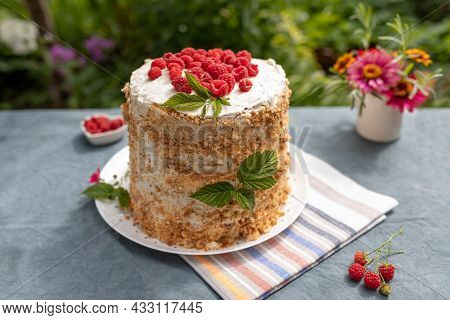 Raspberry Homemade Cake On Table In Garden On Sunny Summer Morning, Small Bouquet Of Garden Flowers