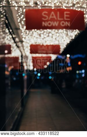 White Abstract Bokeh Made From Buildings And Christmas Lights On Black Isolated Background. Blurred