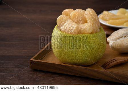 Fresh Pomelo Fruit On Wooden Table Background.