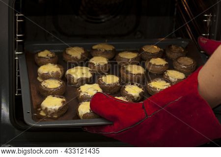 Cooking Mushrooms With Cheese. Cooking Champignons Stuffed With Cheese In The Electric Oven