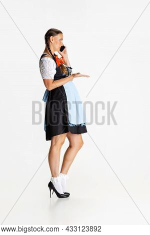 Portrait Of Beautiful Woman, Waitress In Traditional Austrian Or Bavarian Costume Talking On Phone I