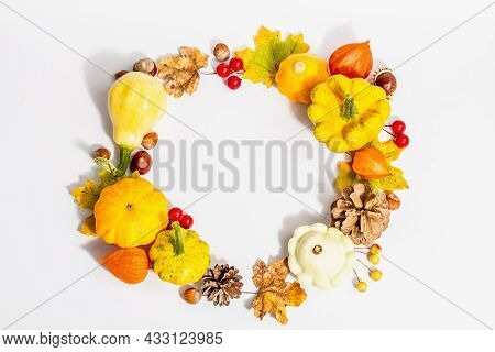 Autumn Wreath Of Pumpkins, Cones, Nuts, Fall Leaves, And Berries Isolated On White Background