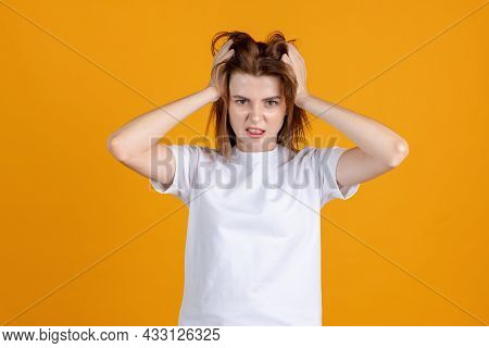 Studio Shot Of Young Cute Girl Isolated On Yellow Color Studio Background. Concept Of Human Emotions