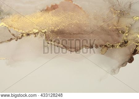 Art Abstract watercolor and acrylic flow blot painting. Brown, beige color with gold glitter. Canvas marble texture background. Alcohol ink.