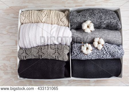 Homemade cosy sweaters in closet organizer with cottton, wool sweater for cold winter