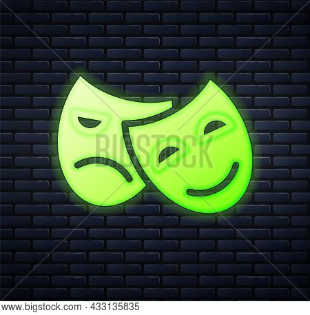 Glowing Neon Comedy And Tragedy Theatrical Masks Icon Isolated On Brick Wall Background. Vector
