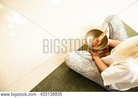 yoga concept, hands and singing bowl for sound healing, healthy lifestyle, wellbeing concept