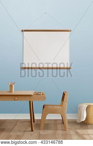 Blank frame hanging in minimal kids room interior design