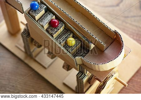 Marble climber made from cardboard. Shallow depth of field.