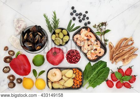 Highly nutritious immune system boosting healthy food, high in antioxidants, anthocyanins, protein, fibre, lycopene vitamins, minerals, omega 3. Health food concept, on marble.