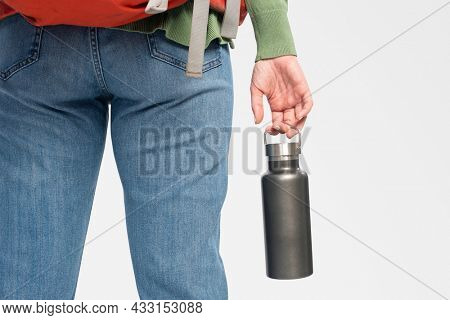 Woman holding a stainless steel water bottle