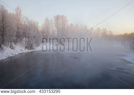 Natural Frosty Winter Background. Steam Rises Above The Water Of A Non-freezing River In Heavy Frost