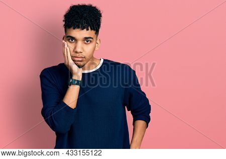 Young african american man wearing casual clothes thinking looking tired and bored with depression problems with crossed arms.