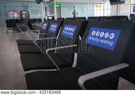 Empty Airport Waiting Terminal Priority Seats. Flight Delay Cancellation. Coronavirus Covid 19 Quara
