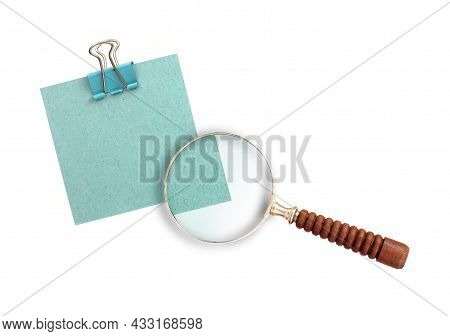 Magnifying Glass (magnifier) And Blue Paper Isolated On White Background