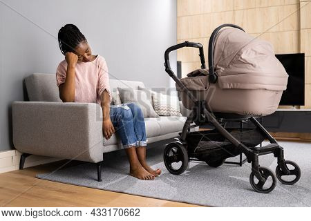 Depressed Unhappy African American Woman With Newborn. Frustrated Mum