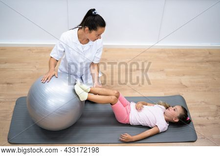 Balance Training Physiotherapy Exercise Treatment For Child. Kid Sport Therapy