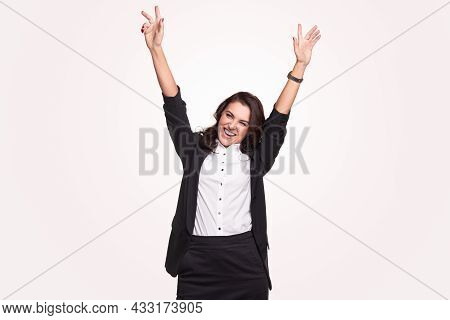 Delighted Adult Business Lady In Formal Outfit Raising Arms And Smiling Happily While Celebrating Ac