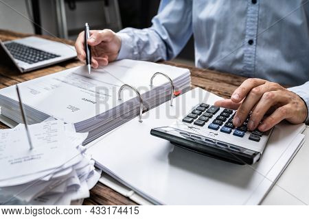 Chartered Accountant Calculating Salary Taxes And Receipts